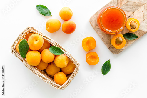 Friut background with apricot jam on white background top view Canvas