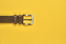 Leather Belt On A Yellow Backg...