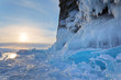 Leinwanddruck Bild - Baikal Lake in February frost. A beautiful winter sunset is reflected in blue ice floes near the icy cliffs of Olkhon Island