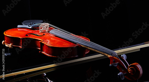 Violin on a black background, close-up. music concept. Details of the violin - 293152733