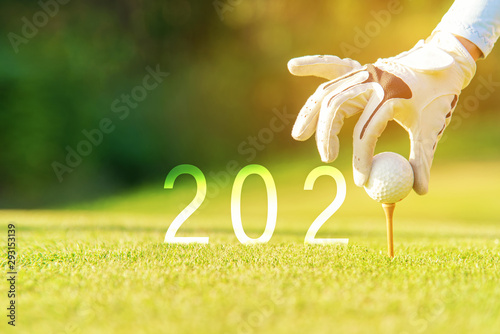 Fotografie, Obraz  Golfer woman putting golf ball for Happy New Year 2020 on the green golf for new healthy sporty, copy space