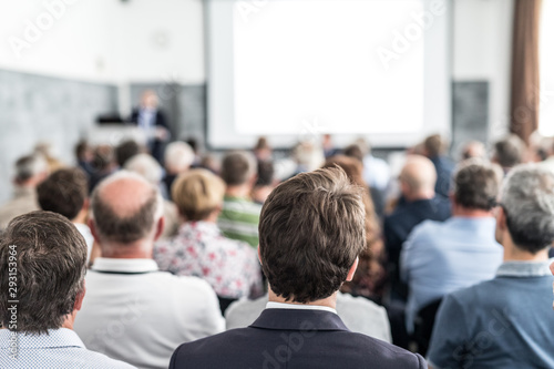 Fototapety, obrazy: Speaker giving a talk in conference hall at business event. Audience at the conference hall. Business and Entrepreneurship concept. Focus on unrecognizable people in audience.