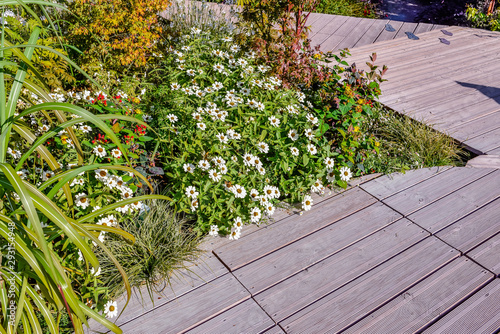 beautiful terrace and wooden driveway in the blooming garden Fototapet