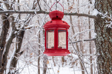 Red Lantern Hanging On A Snowy...