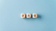 FAQ Sign Over Light Blue Backg...
