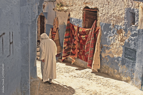 Garden Poster Narrow alley Chefchaouen nomad old man