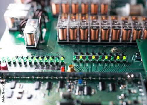 Fototapeta Large green microcircuit and luminous panels obraz