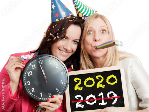 Two women holding a chalkboard and a clock isolated on white background Wallpaper Mural