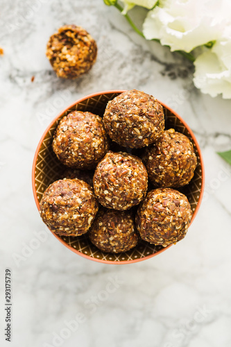 Billede på lærred Energy protein balls with healthy ingredients on marble table