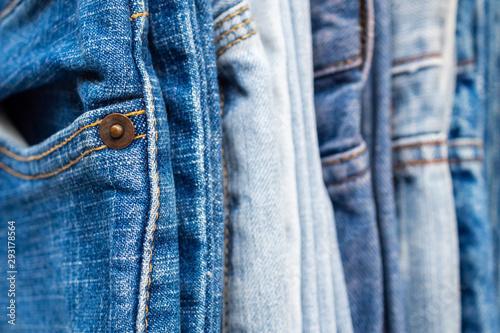 Leinwand Poster denim blue jeans stack texture background closeup