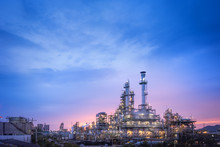 Oil And Gas Refinery Plant Or Petrochemical Industry On Blue Sky Sunset Background, Factory At Twilight Time, Gas Furnace And Smoke Stack In Petrochemical Industrial