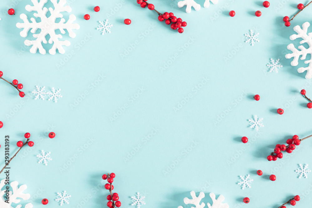 Fototapeta Christmas holiday composition. Xmas white decorations and red berries on pastel blue background. Christmas, New Year, winter concept. Flat lay, top view, copy space