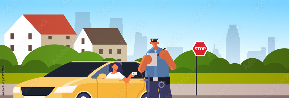 Fototapeta police officer writing report parking fine or speeding ticket for woman sitting in car showing driver license road traffic safety regulations concept cityscape background portrait