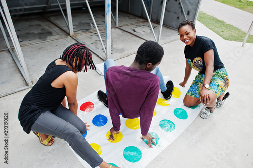 Group of three african american friends play twister game outdoor Canvas-taulu