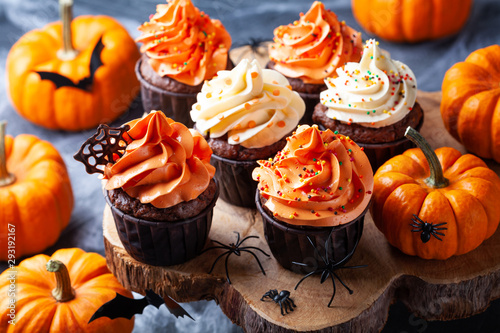 Halloween cupcakes and pumpkins on wooden background Wallpaper Mural