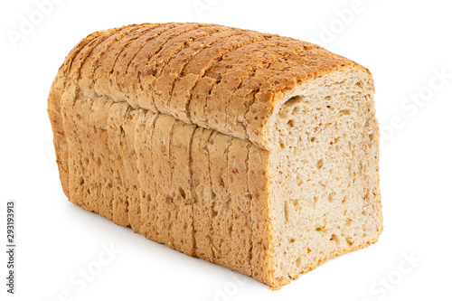 Slika na platnu Sliced loaf of whole wheat toast bread isolated on white.