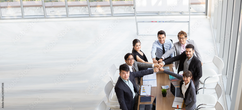 Fototapeta Top view of successful startup entrepreneurs and business people team achieving goals. Aerial view with teamwork of businessman and businesswoman. Business meeting concept