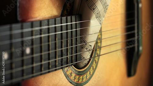 Fényképezés  Guitar strings and roll paper notes, music