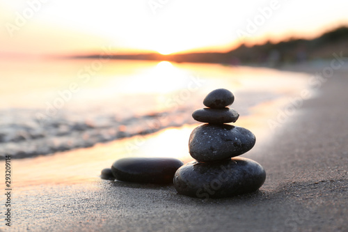 Aluminium Prints Stones in Sand Dark stones on sand near sea at sunset, space for text. Zen concept