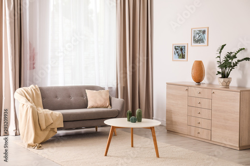 Obraz Stylish living room interior with comfortable furniture - fototapety do salonu