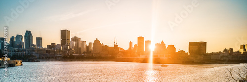 Fototapeta Montreal city skyline at sunset banner background view of downtown from old port, harbourfront panorama. Summer travel destination, Canada, North America. obraz