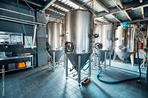 Fermentation mash vats or boiler tanks in a brewery factory Canvas Print