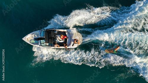 Fényképezés Aerial photo of woman practising waterski in Mediterranean bay with emerald sea