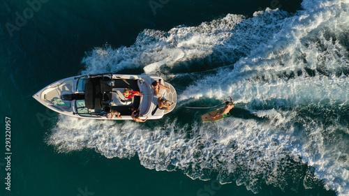 Vászonkép Aerial photo of woman practising waterski in Mediterranean bay with emerald sea