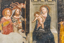 Religious Medieval Fresco Showing Virgin Mary Sitting On A Throne Holding Baby Jesus While Receiving Crusaders