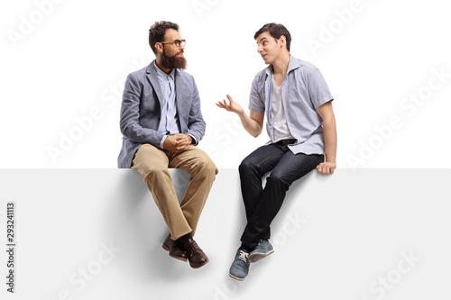 Obraz Men sitting on a banner and talking - fototapety do salonu