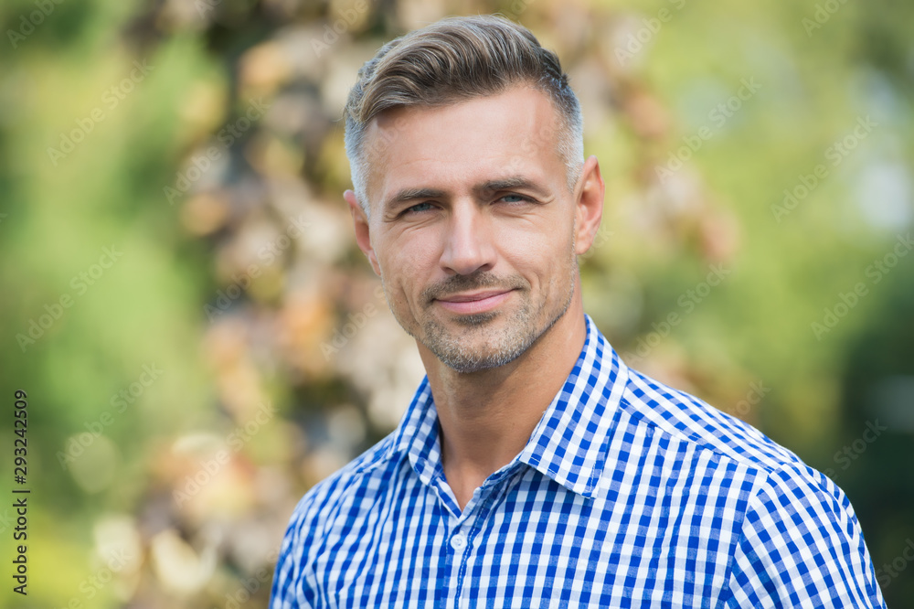 Fototapeta Facial care and ageing. Traits and behaviors that make men more appealing. Attractive mature man. Mature guy with grey hair and bristle. Men get more attractive with age. Beauty of mature face