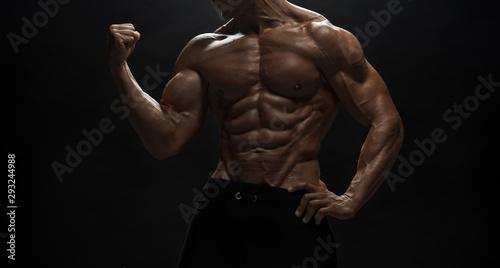 Canvastavla  Fitness model man posing in studio
