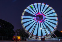 Ferris Wheel Spinning At Night