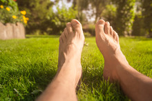 Bare Feet Relaxing In The Grass