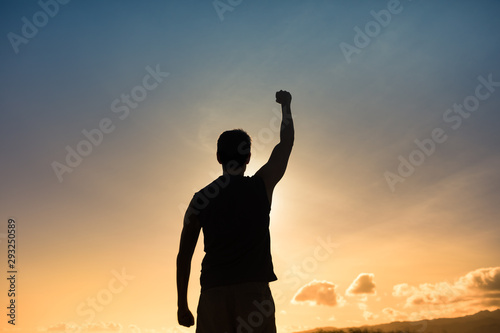 Strong confident muscular Male with fist in the air. Canvas Print