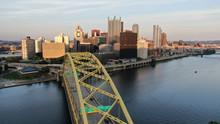 Pittsburgh's Skyline Rises Behind The Fort Pitt Bridge.
