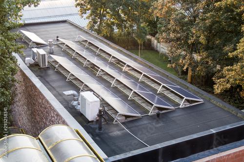 Obraz solar panels on a flat roof - fototapety do salonu