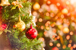 Christmas tree with decorations bokeh blurred glow. Happy New Year and Merry x-mas.