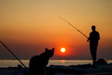 A Fisherman Silhouette Fishing...