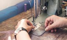 Caucasian Seamstress Working W...
