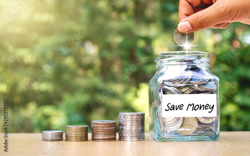 Hands Are Putting Money In A Jar Of Money Money Saving Ideas Buy This Stock Photo And Explore Similar Images At Adobe Stock Adobe Stock