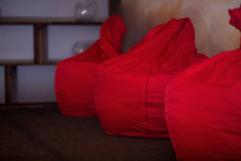 Three Red Bean Bag Chairs In T...