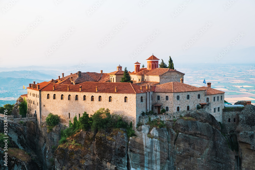 Aerial view of a slide from a drone on a panorama of a mountain range. Kalampaka city, Greece. View of the cliffs of Meteora and the monasteries of Meteora. Many ancient Orthodox monasteries