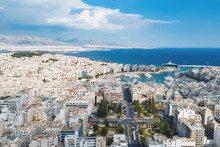 Piraeus, Greece Aerial View Drone On Panorama Of Buildings Of Residential And Administrative Buildings Of The City In Summer On Sunny Day. Roof Plan Aerial View Of The Blue Sea. Front View