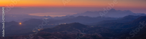 Foto auf AluDibond Aubergine lila Panorama of Skadar Lake in Montenegro during sunrise on a beautiful foggy morning. Visible mountains surrounding the lake