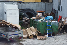 Dumpsters Being Full With Garbage.