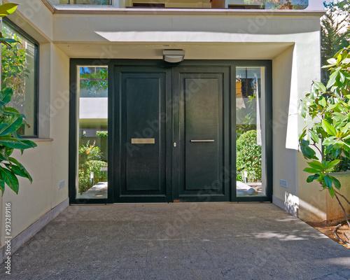 Photo elegant apartment building entrance green metallic door, Athens Greece