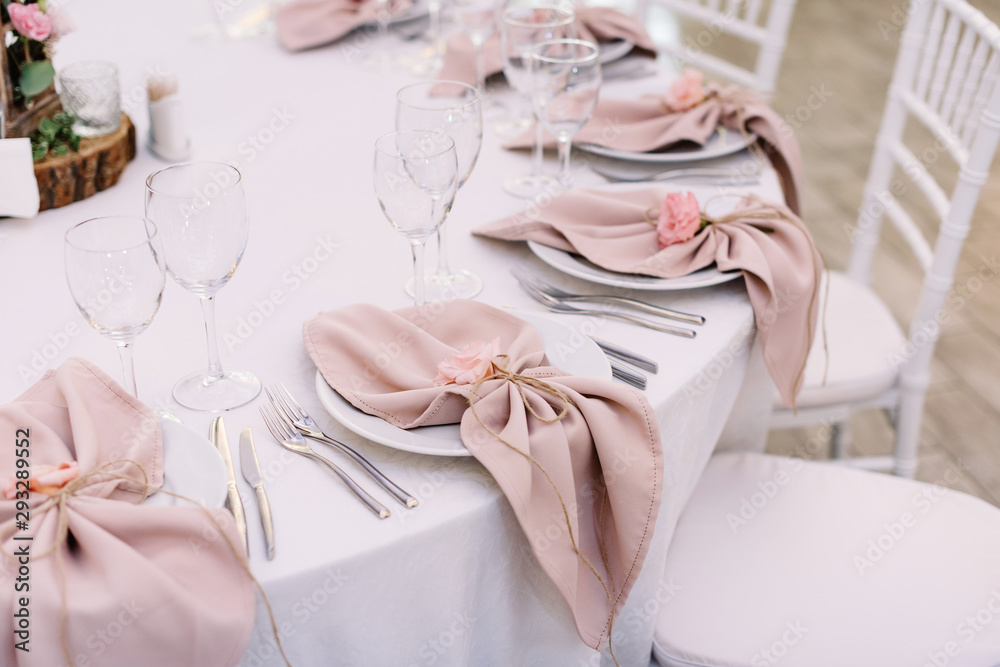 Fototapeta Luxurious wedding table decoration for reception of guests with stylish napkins, cute natural flower