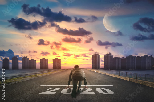 Fototapeta Businessman starting road to success 2020. Elements of this image furnished by NASA. obraz