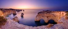 Blue Hour And Sunrise Along The Algarve Coast Towards Faro From The Cliffs Above Praia Da Marinha, Portugal